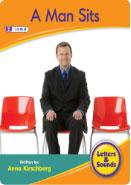 A man sits